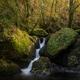 A waterfall rushes between huge boulders - PhotoDune Item for Sale