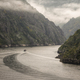 A ship enters a canyon of granitic cliffs - PhotoDune Item for Sale