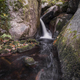A stream forms a water jet between granitic rocks - PhotoDune Item for Sale