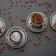 Coffee cups and beans on black color background, top view - PhotoDune Item for Sale