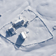 Snow covered remote, heart shaped homestead in the mountains. Aerial drone above view - PhotoDune Item for Sale