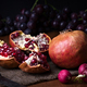 pomegranates and grapes with other fruits bodegon with classic light on wood - PhotoDune Item for Sale