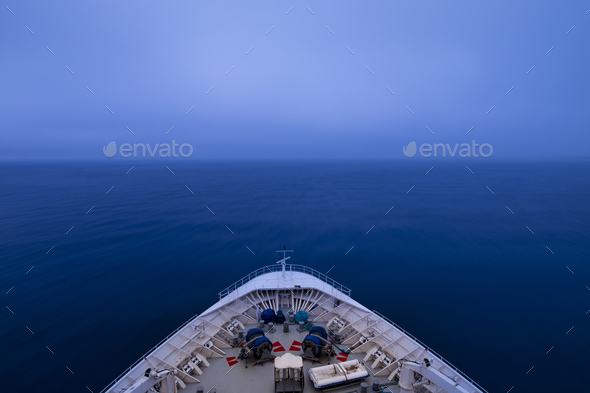 POV shot of bow of a ship sailing into a fog bank in pre dawn ho - Stock Photo - Images