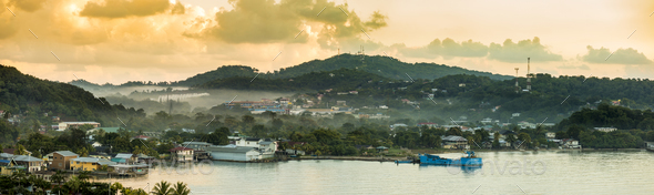 Panorama of Coxen Hole, Roatan with fog in first morning light. - Stock Photo - Images