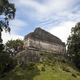 pyramid partially overgrown in the Dzibanche Mayan complex in Me - PhotoDune Item for Sale