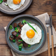 Sunny side fried egg with croutons and herbs, close view - PhotoDune Item for Sale