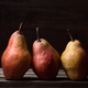 pears in row on rustic wooden boards in dark stage - PhotoDune Item for Sale