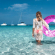 Young woman in white lace dress with pink swim ring in the sea - PhotoDune Item for Sale