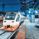 High speed train on the railway station at night in winter - PhotoDune Item for Sale