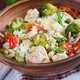 Delicious chicken, broccoli, green peas, tomato stir fry with rice. Asian cuisine. Healthy food. - PhotoDune Item for Sale