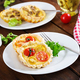 Cheddar, tomatoes tartlets on wooden background. Mini pies. Delicious appetizer, tapas, snack. - PhotoDune Item for Sale