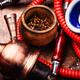 Smoking shisha with tobacco - PhotoDune Item for Sale