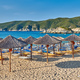 Beach with loungers and umbrellas in Greece - PhotoDune Item for Sale