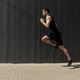 A side view shot of a fit young, athletic man jumping and running. - PhotoDune Item for Sale