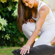 Happy pregnant woman with a big belly pats her dog in the garden - PhotoDune Item for Sale