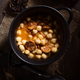 homemade chickpea stew with bread and wine on rustic wooden board illuminated in chiaroscuro - PhotoDune Item for Sale