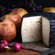 Spanish sheep cheese with pomegranates, pears and grapes, still life with classic light on wood - PhotoDune Item for Sale