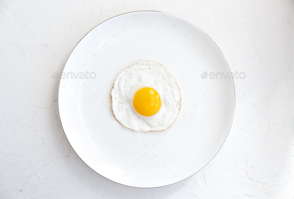 Fried egg isolated on white background, top view - Stock Photo - Images