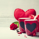 Valentine's Day concept. Red Cups and roses on a Wooden Background - PhotoDune Item for Sale