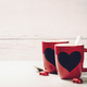 Valentine's Day concept. Red Cups on a Wooden Background. - PhotoDune Item for Sale