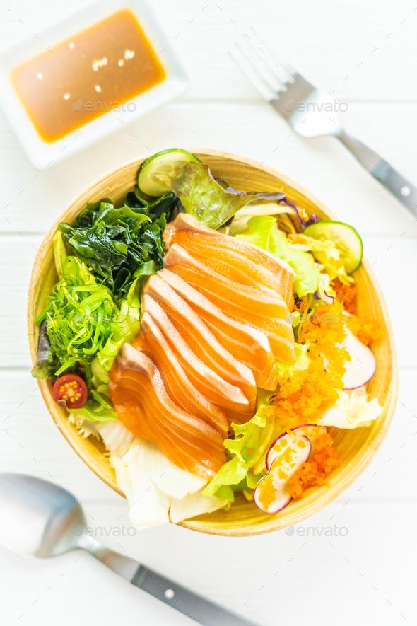 Raw fresh salmon fish meat sashimi with seaweed and other vegeta - Stock Photo - Images