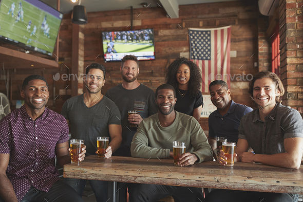 Group Of Friends Meeting And Drinking Beer In Sports Bar Together At Camera - Stock Photo - Images