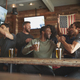 Group Of Friends Watching Game On Screen In Sports Bar - PhotoDune Item for Sale