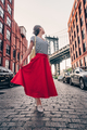 Beautiful girl in a red skirt on the background of the bridge - PhotoDune Item for Sale