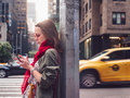 Attractive girl with a phone outdoors - PhotoDune Item for Sale