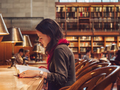 Young woman in the library - PhotoDune Item for Sale