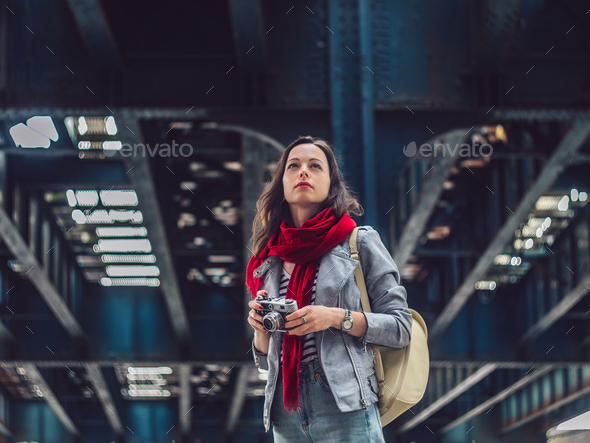 Young girl with a retro camera outdoors - Stock Photo - Images
