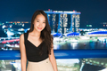 Beautiful Asian women smile and happy with singapore city view - PhotoDune Item for Sale