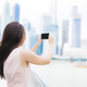 Asian woman using smartphone or mobile phone for taking a photos - PhotoDune Item for Sale