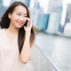 Asian woman using smartphone or mobile phone for talking or text - PhotoDune Item for Sale