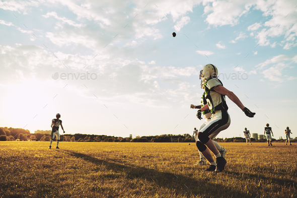 American football player running for a pass during practice - Stock Photo - Images