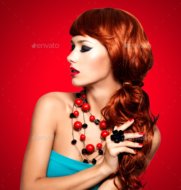 Beautiful fashionable woman with red nails and red hairs - Stock Photo - Images