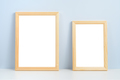 Two wooden photo frames standing on shelf - PhotoDune Item for Sale