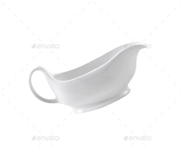 Ceramic cream jug isolated on white background - Stock Photo - Images