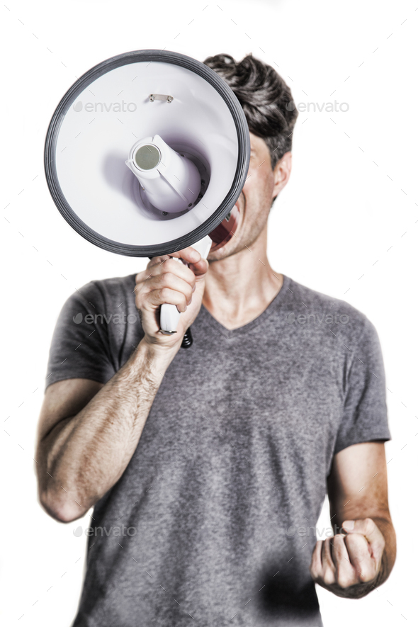 isolated portrait of a man shouting using a megaphone - Stock Photo - Images