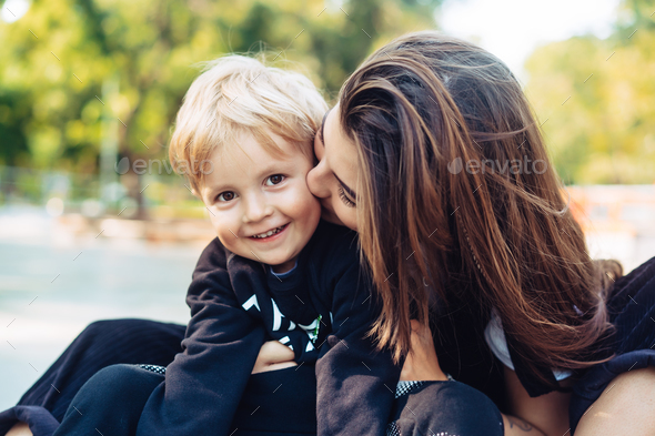 Young mother is playing with her child outside - Stock Photo - Images