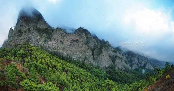 Tumbling clouds over a mountain ridge - Stock Photo - Images