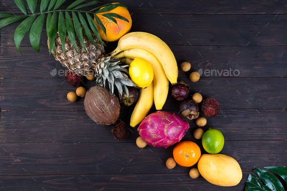 Summer colorfull concept border with tropical fruits and leaves, flat lay, space for a text - Stock Photo - Images