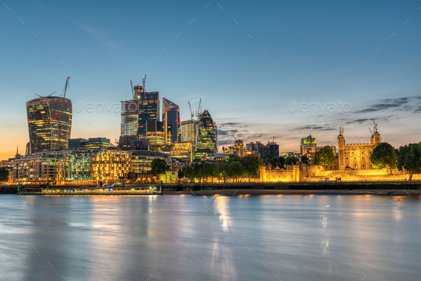 The skyscrapers of the City and the Tower of London  - Stock Photo - Images