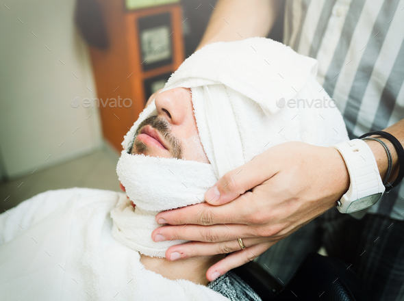 Traditional ritual of shaving the beard - Stock Photo - Images