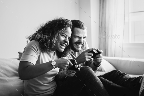 Couple playing game at home together - Stock Photo - Images