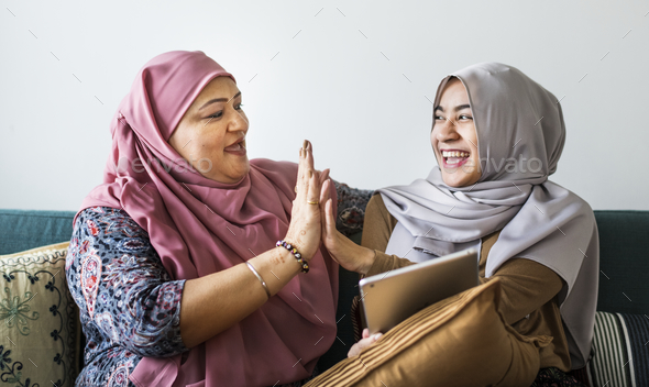 Muslim women using a tablet - Stock Photo - Images