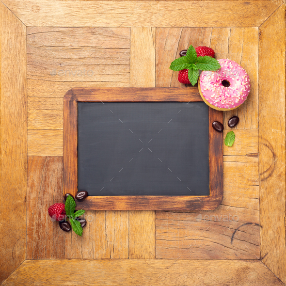 Black chalkboard with pink glazed donut - Stock Photo - Images