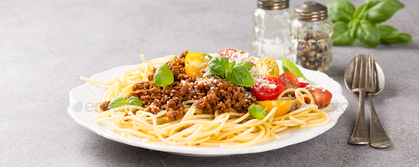 Spaghetti Bolognaise topped with minced beef - Stock Photo - Images