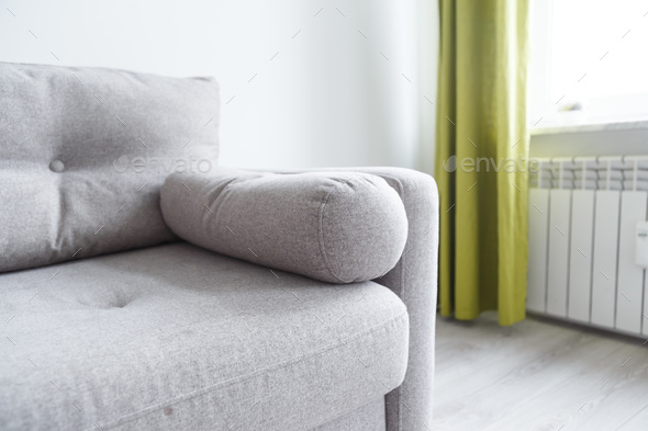 Grey Sofa In Monochromatic Living Room With Green Curtains