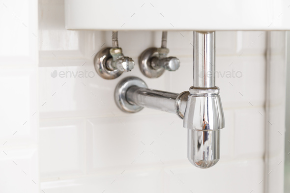 Basin siphon or sink drain in a bathroom, clean - Stock Photo - Images
